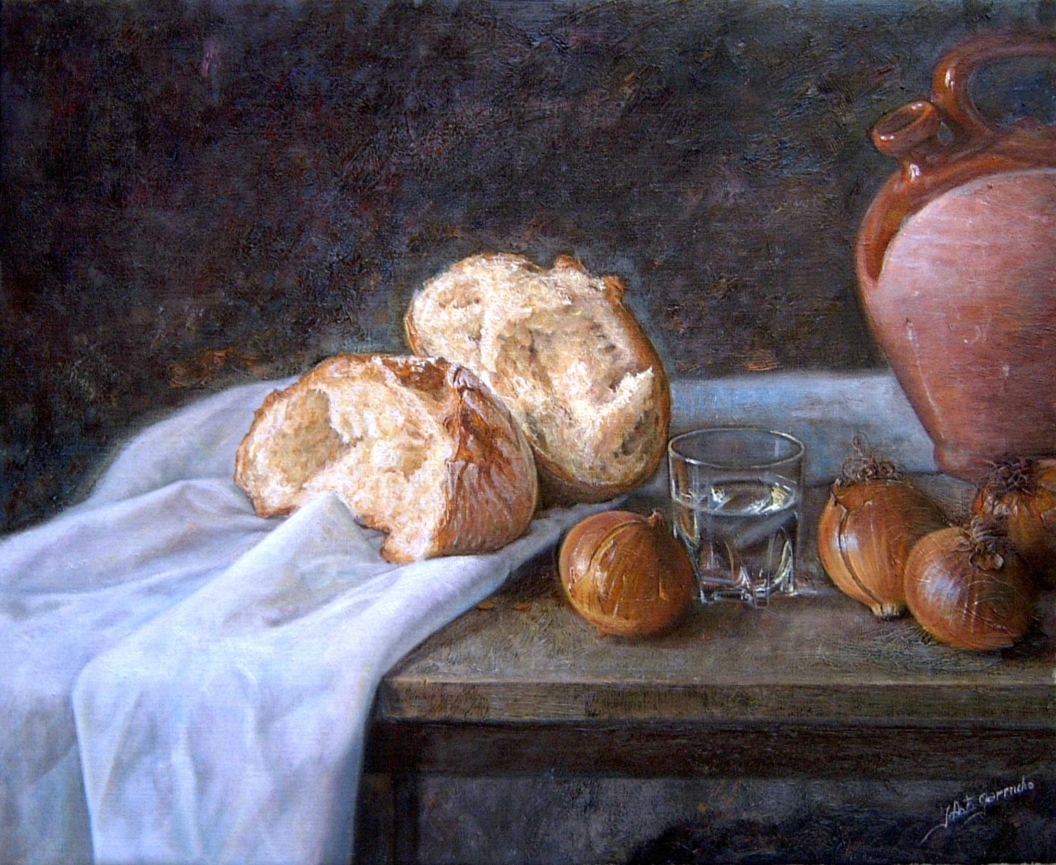 Pan, cebollas, vaso de agua y botijo