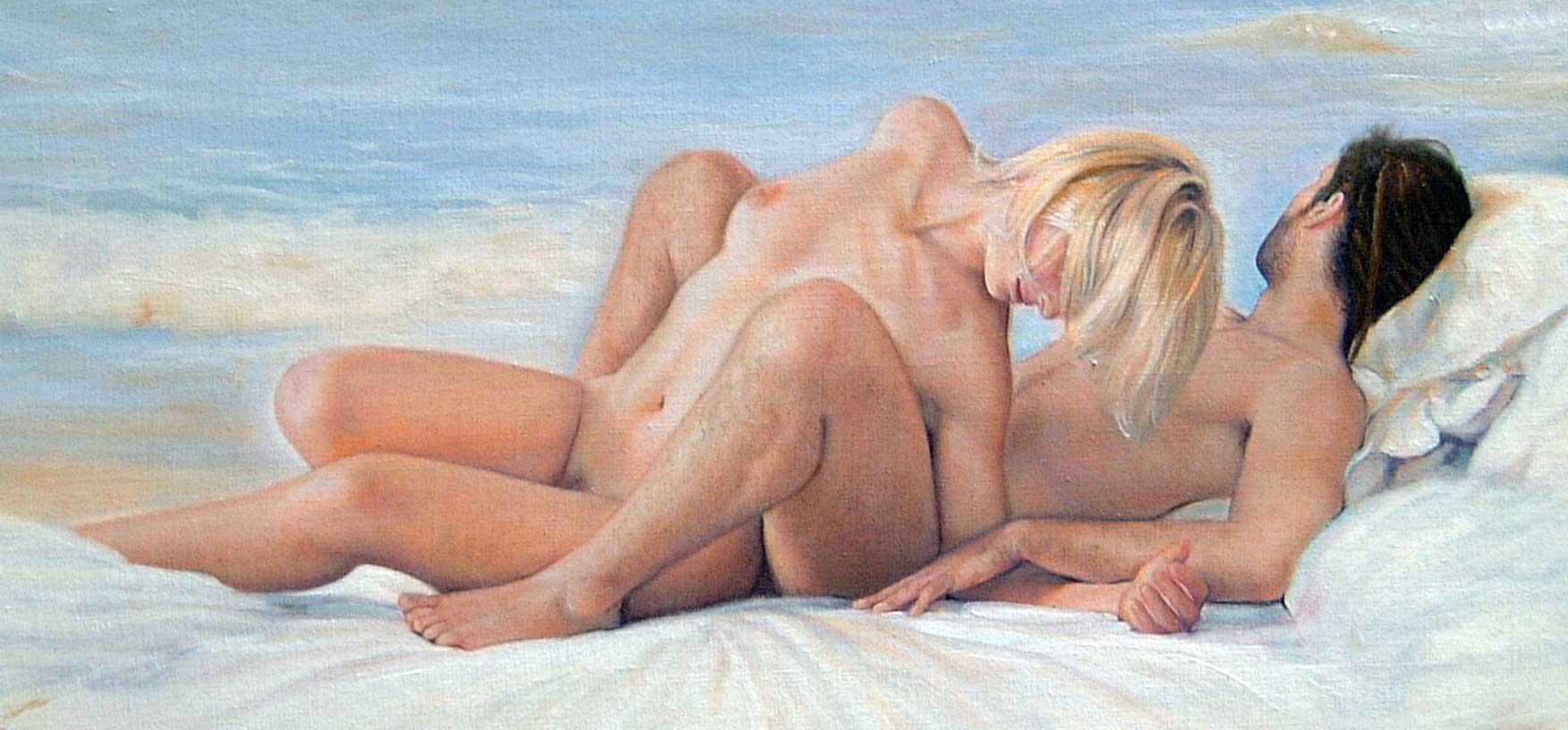 Desnudo pareja en la playa